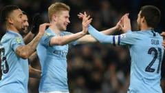 Image of Kevin de Bruyne, David Silva and Gabriel Jesus celebrating.