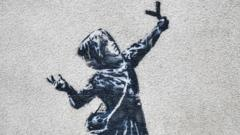 Banksy's girl with a slingshot