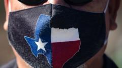 Man wearing Texas state flag mask
