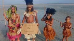 Children standing on a beach
