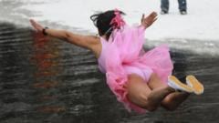 Swimmer in pink tutu diving