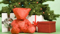wrapped-up-teddy-bear-under-christmas-tree.