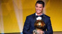 Cristiano Ronaldo receives the 2014 FIFA Ballon d'Or award for the player of the year.