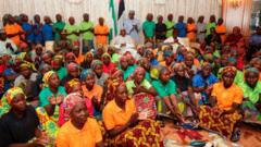 Nigeria's President Muhammadu Buhari, pictured sitting among the 82 rescued Chibok girls during a reception ceremony at the Presidential Villa in Abuja, on 7 May, 2017