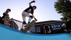 a-young-girl-on-a-skateboard-about-to-drop-into-a-bowl