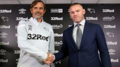 Waynr-Rooney-shakes-hands-with-Derby-County-manager-Phillip-Cocu.