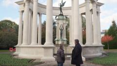Dafydd and his dad look at the cenotaph in Cardiff