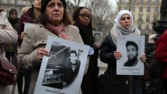 """Activists hold portraits of detained or missing Syrians at a demonstration in Paris, France, organised by """"Families for Freedom"""" (27 January 2018)"""