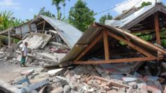 An Indonesian man examines the remains of houses, after a 6.4 magnitude earthquake struck, in Lombok on July 29, 2018.