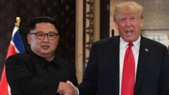 Kim Jong-Un and President Trump shake hands