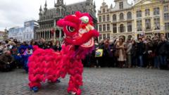 People look at the Chinese Lunar New Year celebrations parade for the beginning of the Year of the Monkey in Brussels
