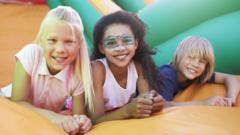 Kids on a bouncy castle.