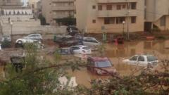 Cars were swept along by the floods in the town of Sa Coma, near S'illot on the Spanish island of Majorca