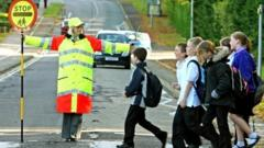 a lollipop lady with children.