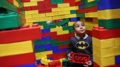 A young boy playing with Lego