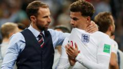 Gareth Southgate and Dele Alli standing together after England's World Cup loss