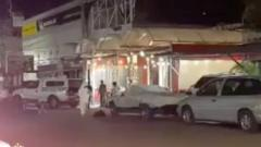 Emergency officials stand outside a bar after gunmen shot dead a journalist early on Sunday in the Mexican city of Iguala in the southwestern state of Guerrero, according to local authorities, August 2, 2020, in this still image taken from video obtained from social media