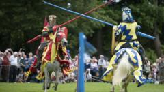 Two knights joust at a modern re-enactment show