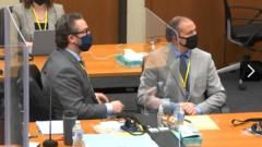 Derek Chauvin and his lawyer Eric Nelson in court