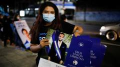 "A supporter of the Nuevas Ideas political party holds calendars with the picture of El Salvador""s President Nayib Bukele as she takes part in a rally during the last day of election campaign in San Salvador, El Salvador, February 24, 2021"