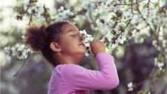 young-girl-smelling-blossom