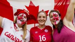 Canadian fans cheer their team prior to the FIFA Women's World Cup 2015 Quarter Final match between Canada and England in Vancouver, Canada,