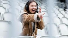 A young girl watching sport