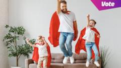dad and two children jump in air with superhero capes