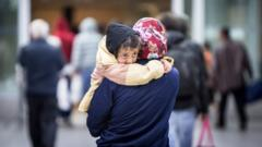 Refugees arrive at the airport train station in Duesseldorf, North Rhine Westphalia, Germany, early 09 September 2015.