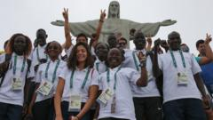 Members of the Refugee Olympic Team pose for a photo in front of the Christ the Redeemer statue on July 30, 2016 in Rio de Janeiro, Brazil.