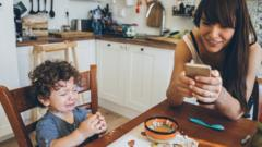 Image of child crying whilst mum is on phone