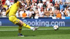 Jordan-Pickford-takes-his-penalty.