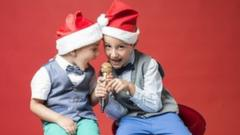 boys-santa-hats-singing-microphone.