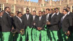 The Fiji rugby squad sang a hymn in front of Hampton Court Palace, on arrival to the UK