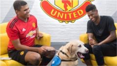 Manchester United's Marcus Rashford meets 15-year-old blind footballer Rainbow and his guide dog, Drake.