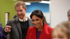 Harry and Meghan laughing at an event