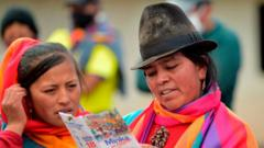 Local women read a leaflet, in San Jose de Rubios, in the parish of Cusubamba, about 100 km south of Quito, on February 2, 2021
