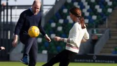 Prince William and Kate play football with children