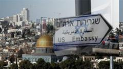 Blended image of the US embassy sign and skyline of Jerusalem
