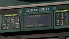 A view of the final scoreboard (score board) as Roger Federer of Switzerland defeats Andy Roddick of USA 5-7, 7-6, 7-6, 3-6, 16-14