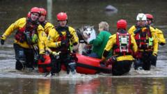 Rescue-workers-and-woman-and-dog-in-boat-on-street-during-Storm-Dennis.