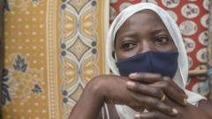 Woman in Mozambique wearing mask, fled conflict in Cabo Delgado province.