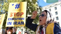 People protest against the death penalty in Iran opposite Downing Street as a march to demand a people's vote against Brexit passes by on October 20, 2018 in London, UK