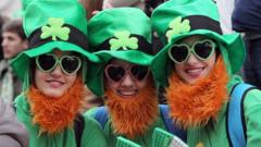 Spectators dressed as leprechauns attend St Patrick's Day parade in Dublin on March 17, 2014.