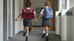 Girls running to school