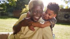 child hugging grandparent
