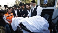 Israeli Ultra-Orthodox mourners attend a funeral after the stampede during at Mount Meron, in Jerusalem