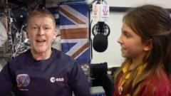 Tim Peake and school child