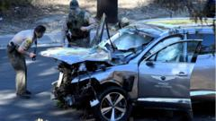 """Los Angeles County Sheriff""""s Deputies inspect the vehicle of golfer Tiger Woods after the accident in Los Angeles, California, February 23, 2021"""