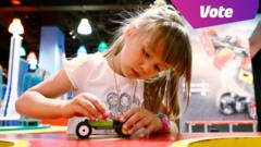 A young girl playing with lego